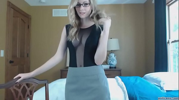 Classy young blonde with glasses sucks a dildo on cam like a slut